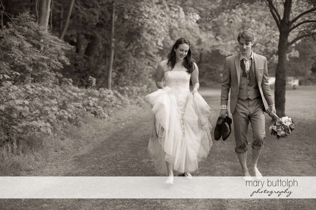 Couple walk home after spending time in the lake at Taughannock Falls Wedding