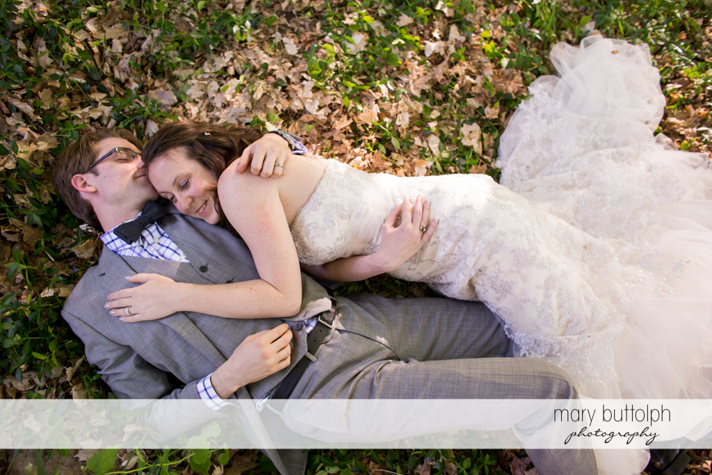 Couple get romantic in the woods at Taughannock Falls Wedding