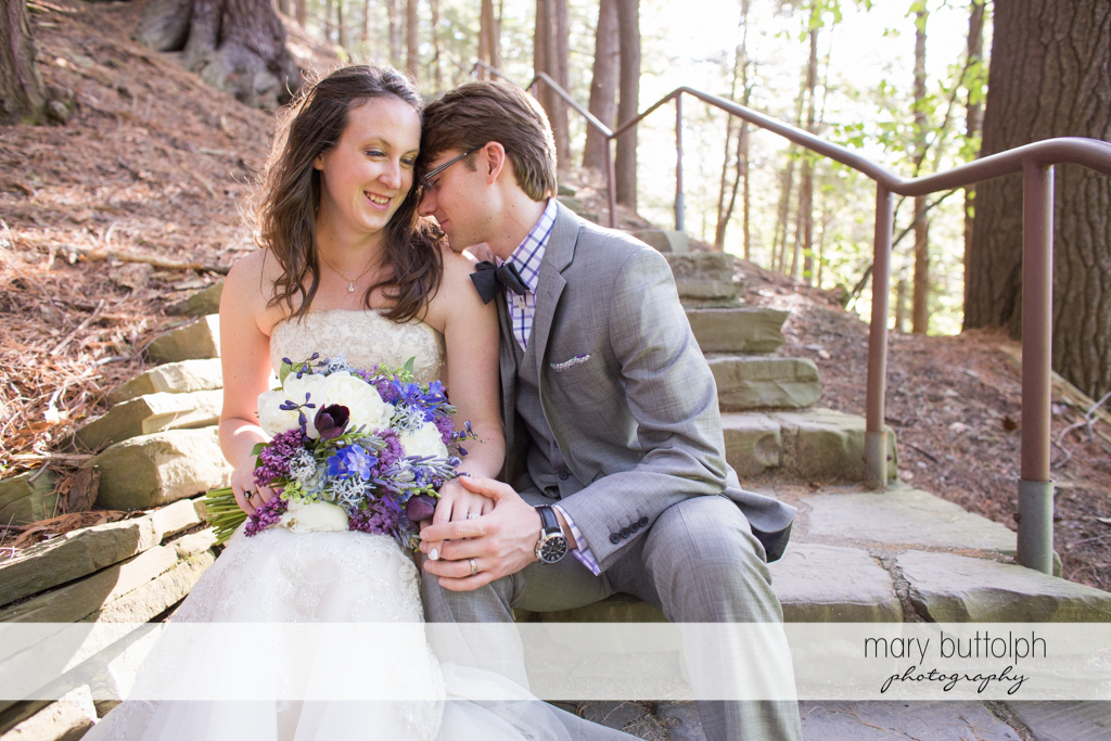 Couple relax on the stone steps at Taughannock Falls Wedding