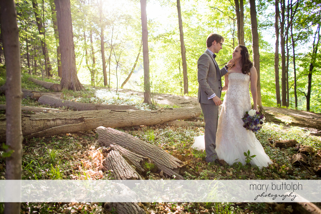 Couple share a tender moment in the woods at Taughannock Falls Wedding