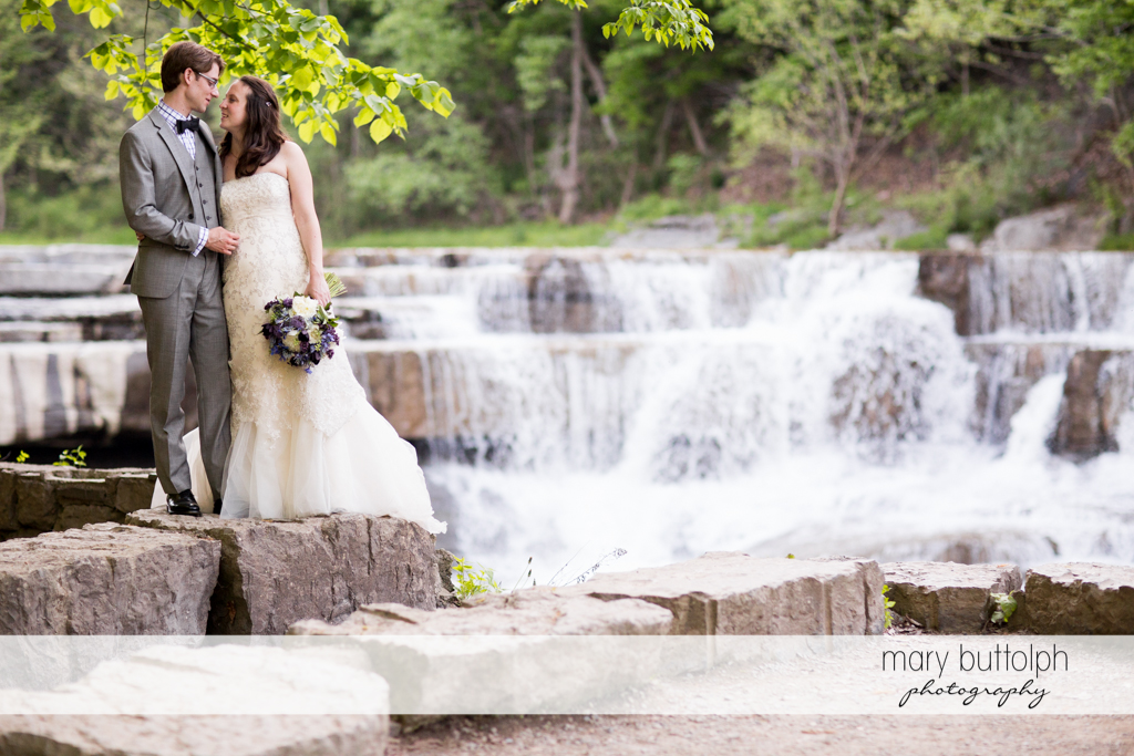 Couple stand near the lake at Taughannock Falls Wedding