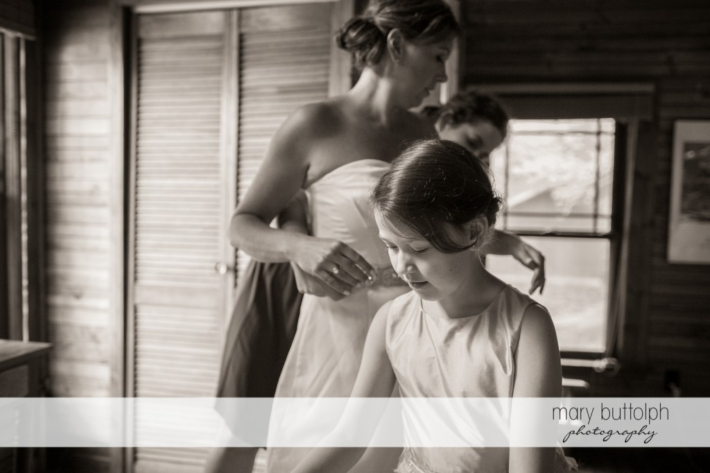 Bride and young girl prepare for the wedding at Skaneateles Country Club Wedding
