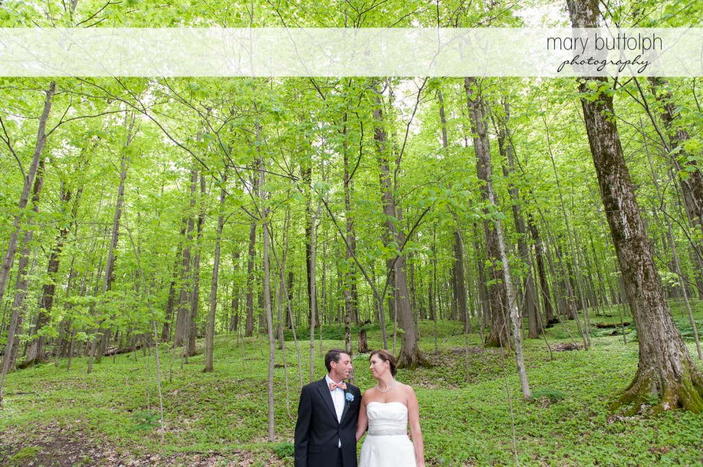 Couple stroll in the woods at Skaneateles Country Club Wedding