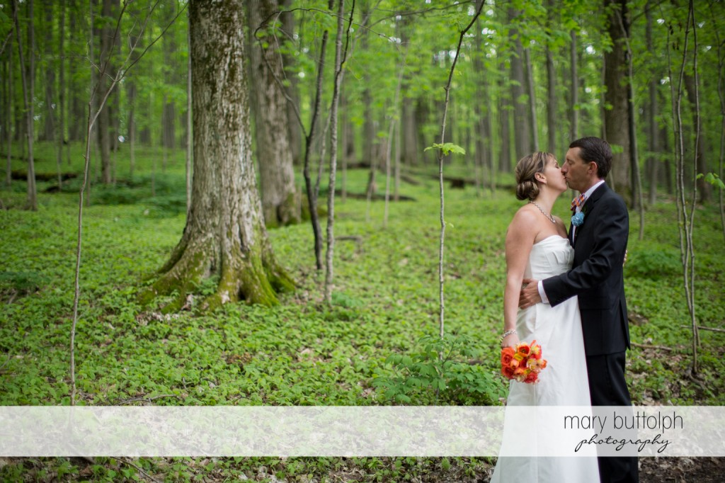 Couple get romantic in the woods at Skaneateles Country Club Wedding