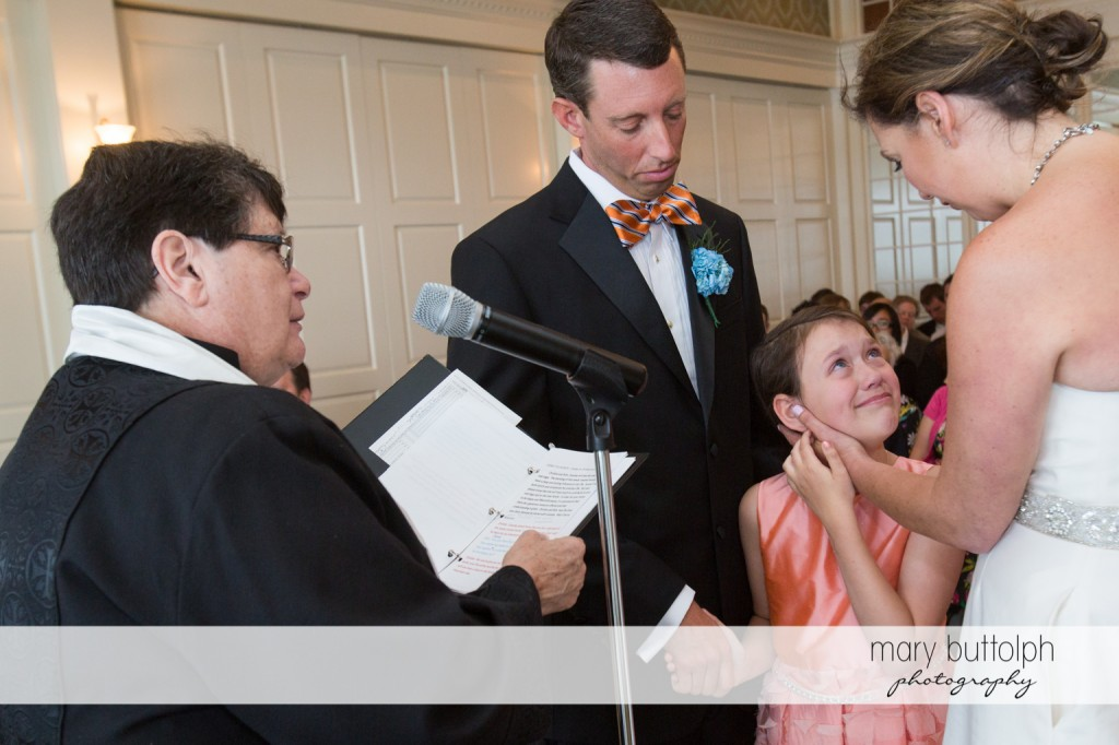 Young girl joins the couple in front of the priest at Skaneateles Country Club Wedding