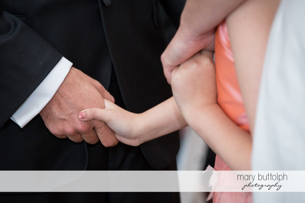 Couple hold young girl's hands at Skaneateles Country Club Wedding