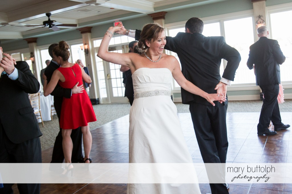 Couple dance with guests at Skaneateles Country Club Wedding
