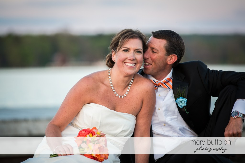 Groom whispers to the smiling bride at Skaneateles Country Club Wedding