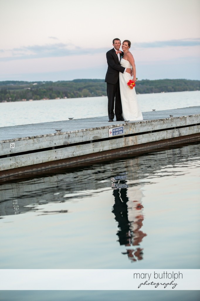 Couple pose by the lake at Skaneateles Country Club Wedding