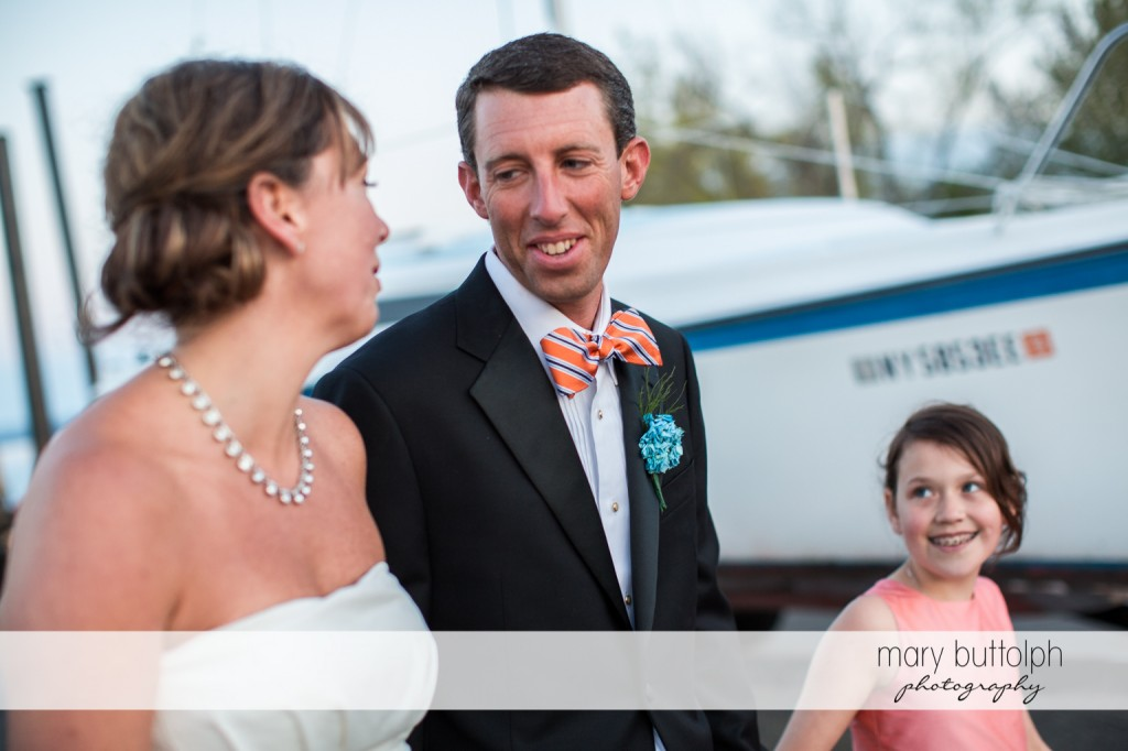 Couple and young girl go for a stroll on the docks at Skaneateles Country Club Wedding