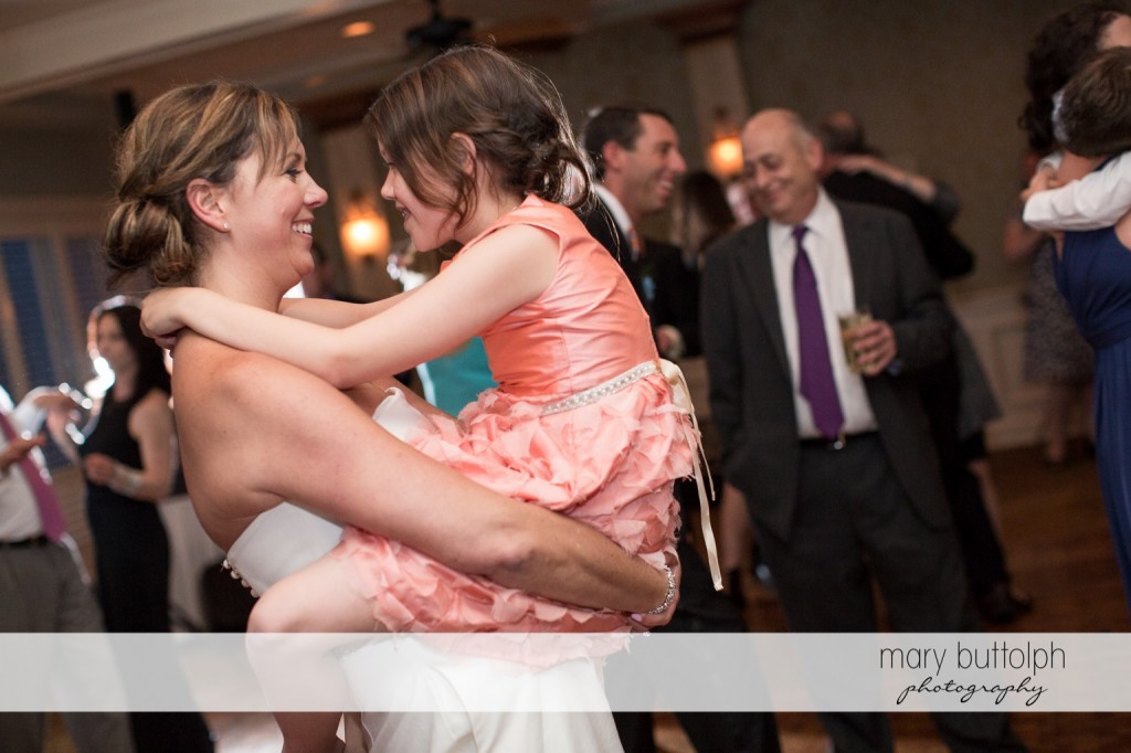 Bride carries the young girl on the dance floor at Skaneateles Country Club Wedding