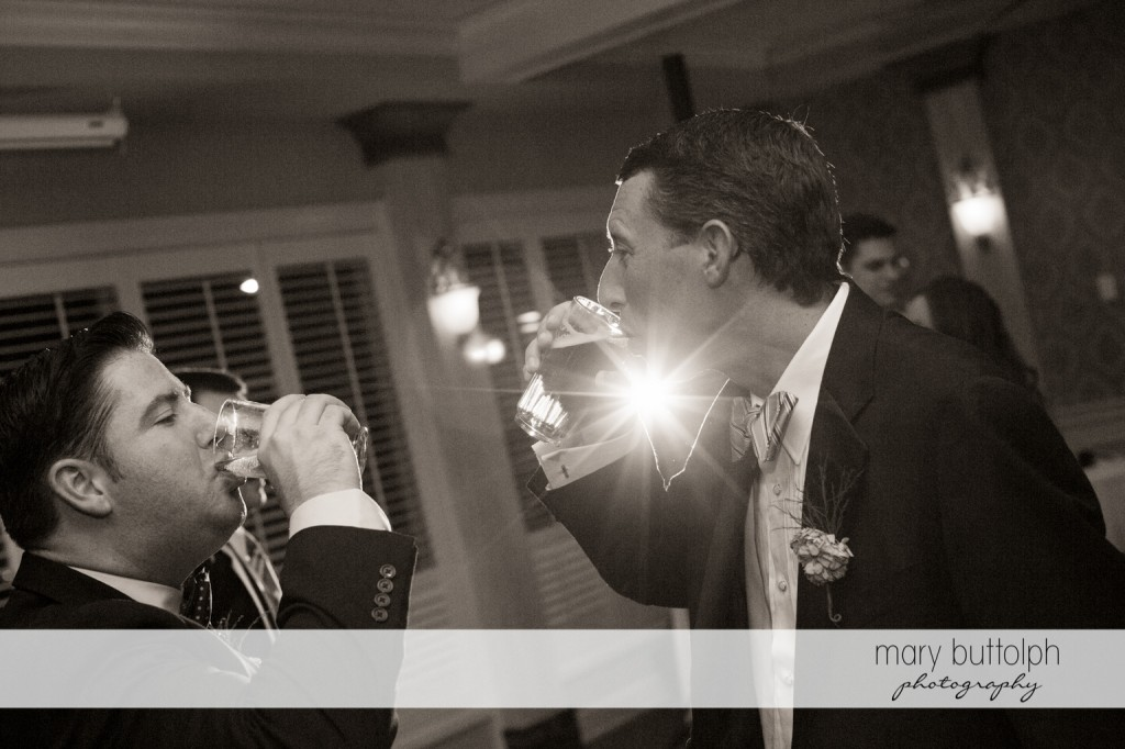 Groom and friend have a drink at Skaneateles Country Club Wedding