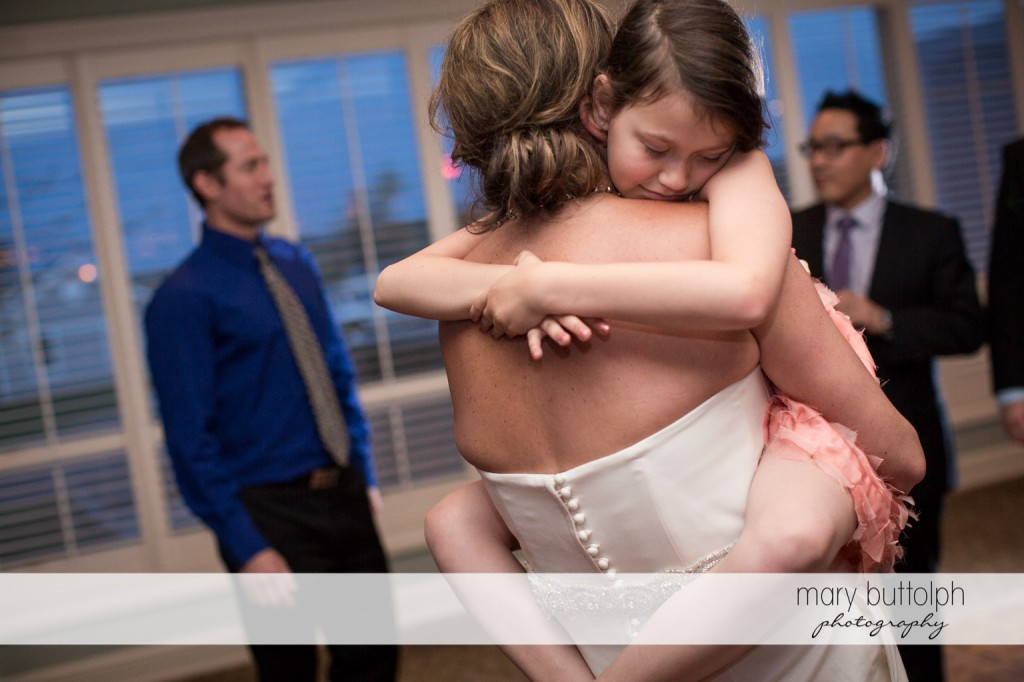 Young girl falls asleep while being carried by the bride at Skaneateles Country Club Wedding