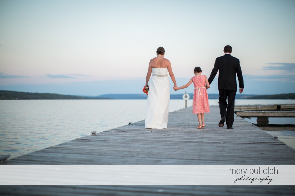 Couple and young girl on the docks at Skaneateles Country Club Wedding