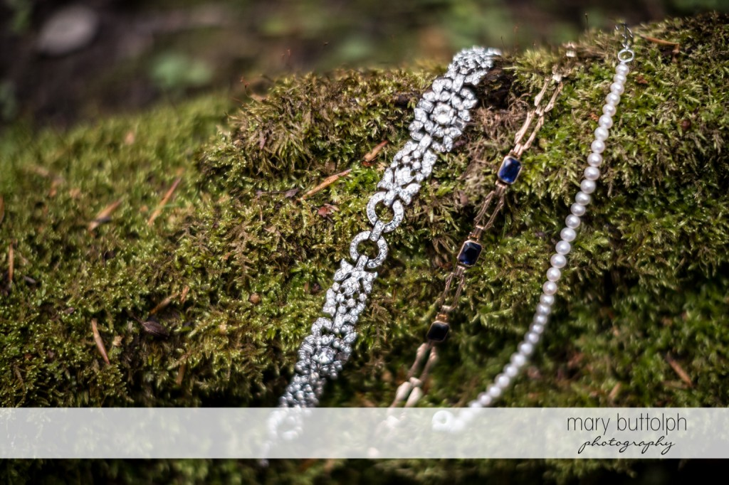 The bride's bracelets in the woods at Skaneateles Country Club Wedding