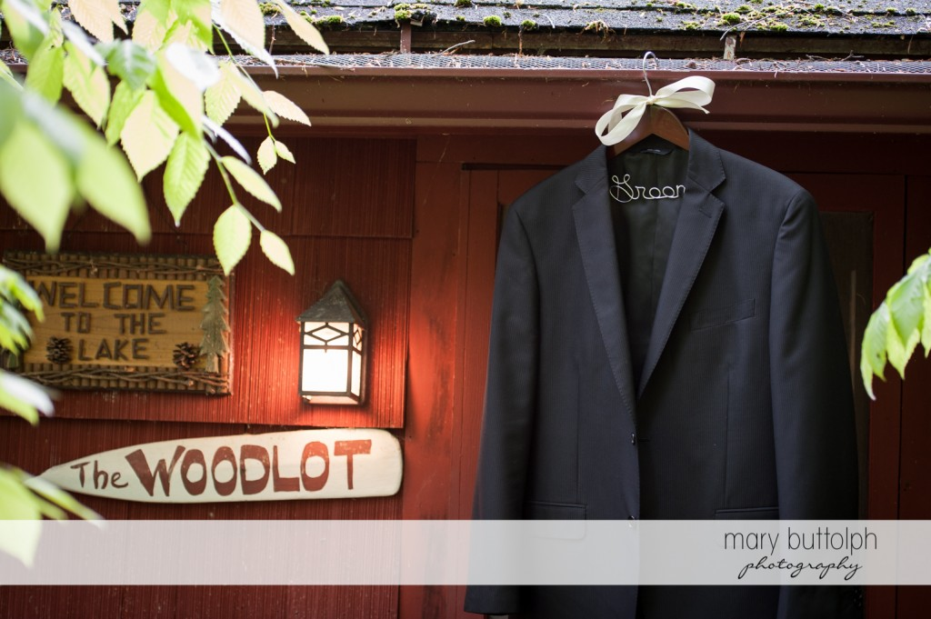 The groom's coat hanging on the roof at Skaneateles Country Club Wedding