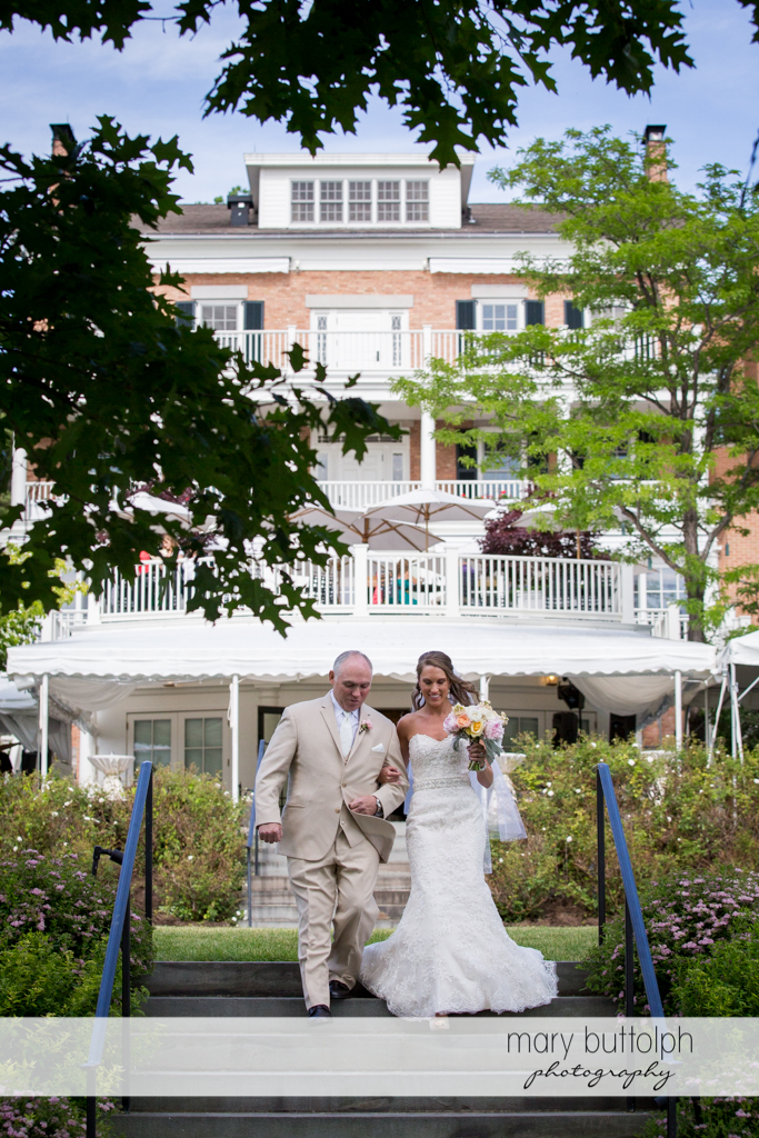 Bride and her father leave the inn at the Inns of Aurora Wedding