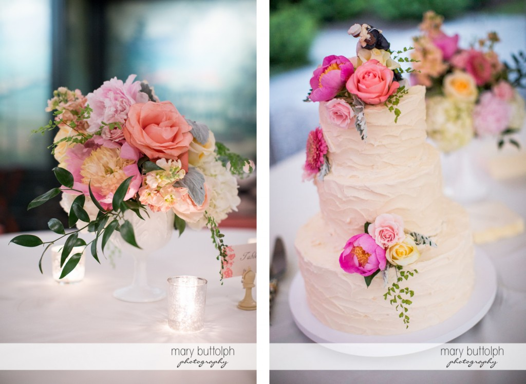 Flowers decorate the table and the wedding cake at the Inns of Aurora Wedding