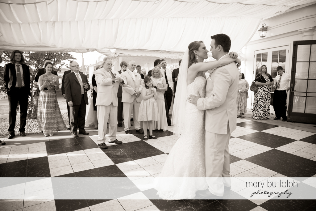 Couple dance in front of guests at the Inns of Aurora Wedding