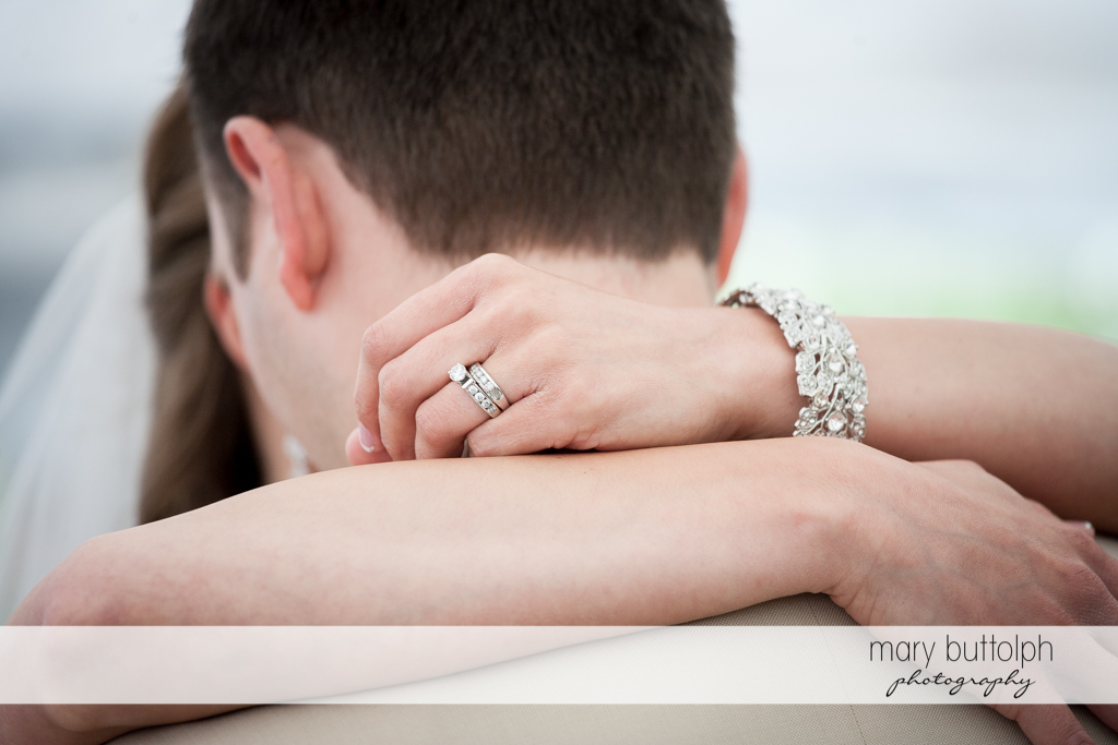 Bride's wedding ring and bracelet are seen when the couple dance at the Inns of Aurora Wedding