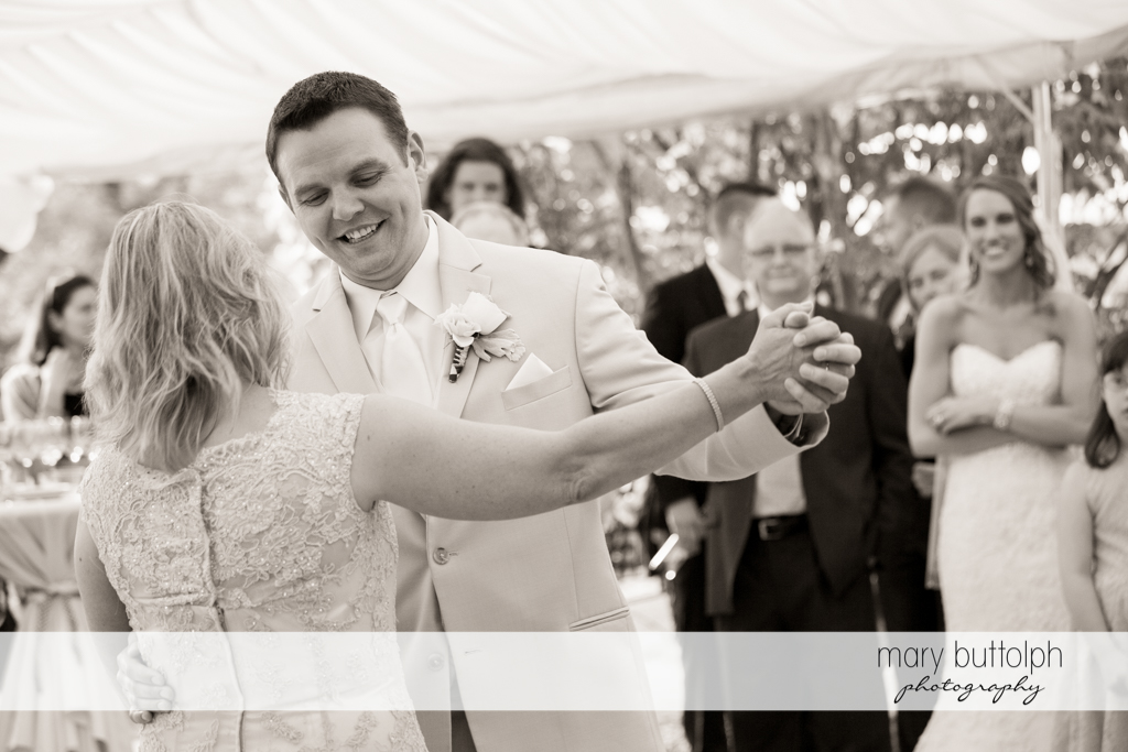 Groom dances with the bride's mother at the Inns of Aurora Wedding