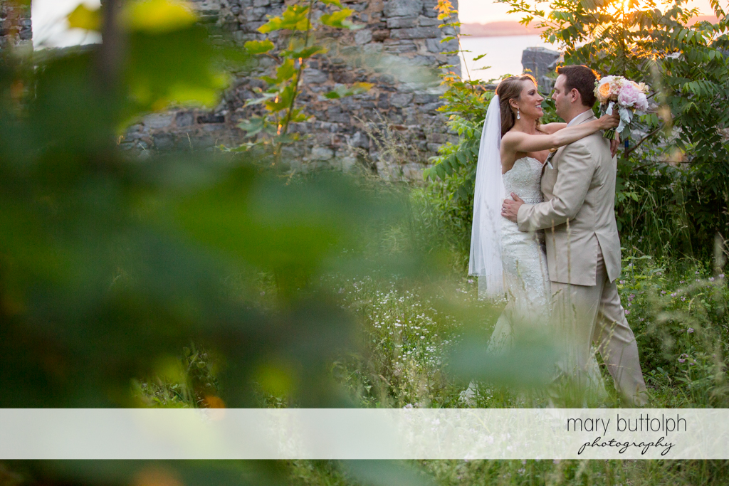 Couple embrace near the ruins at the Inns of Aurora Wedding