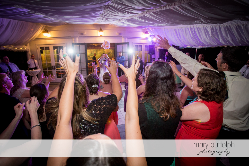 Bride throws the bouquet to the women at the Inns of Aurora Wedding