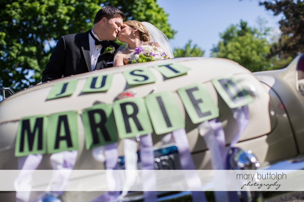 Newly married couple take a ride at Emerson Park Pavilion Wedding