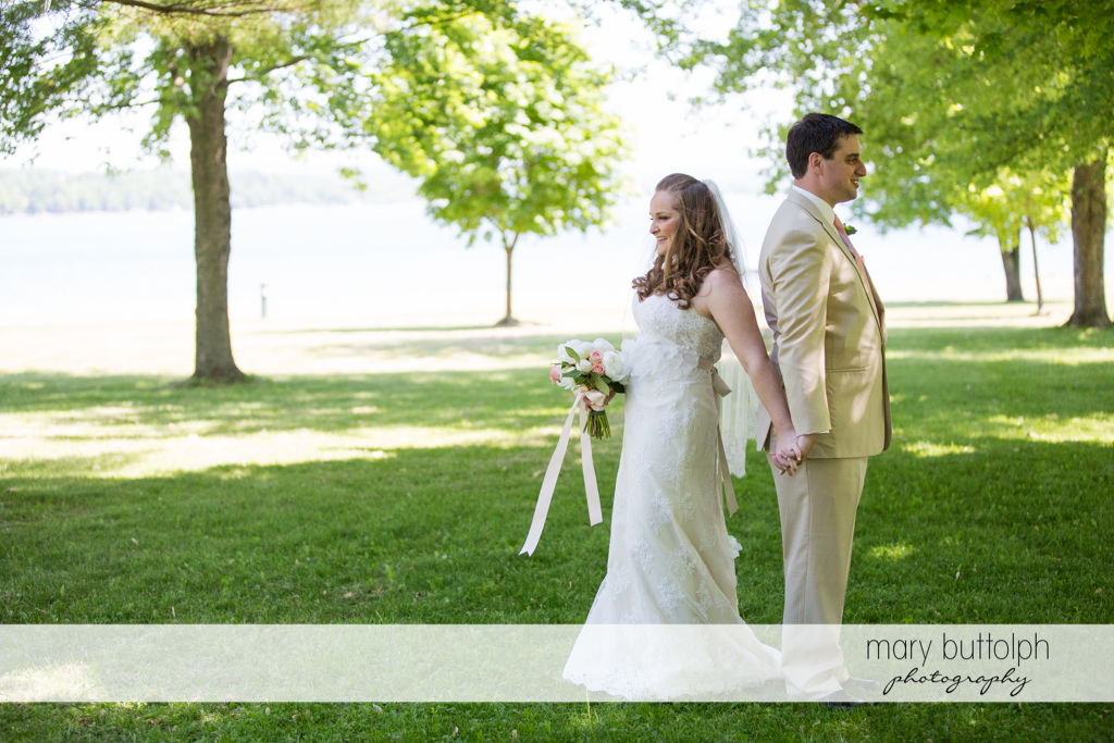 Couple stand back to back in the garden at Emerson Park Pavilion Wedding