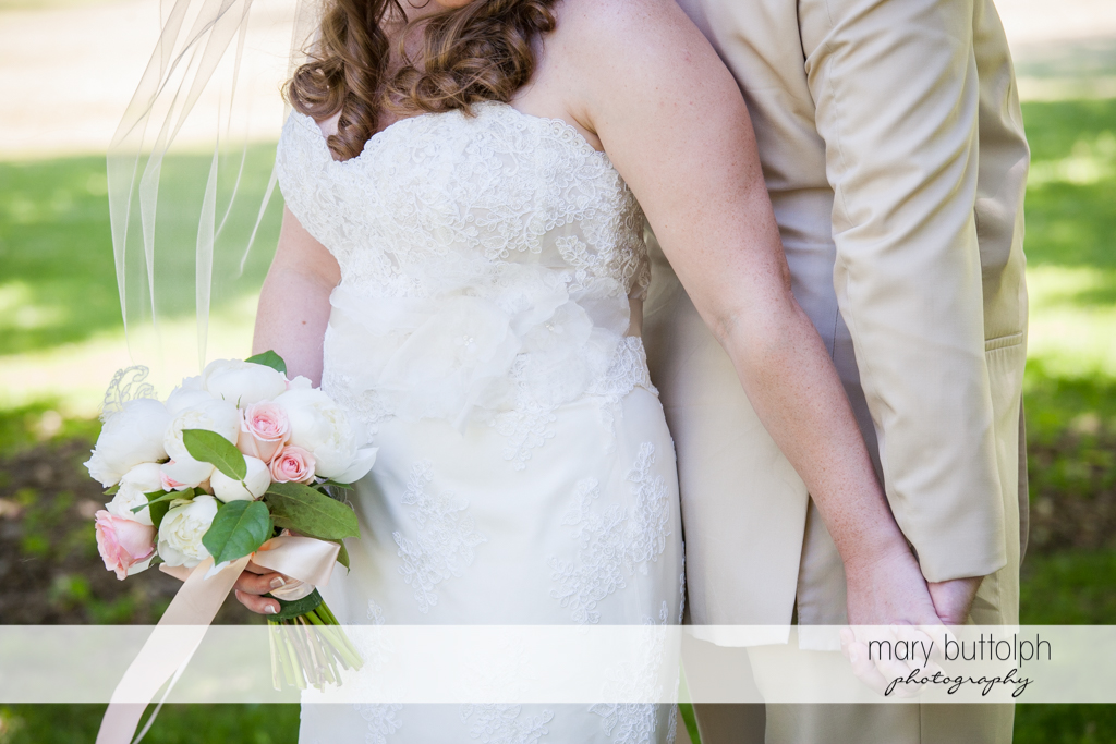 Medium shot of couple holding hands in the garden at Emerson Park Pavilion Wedding