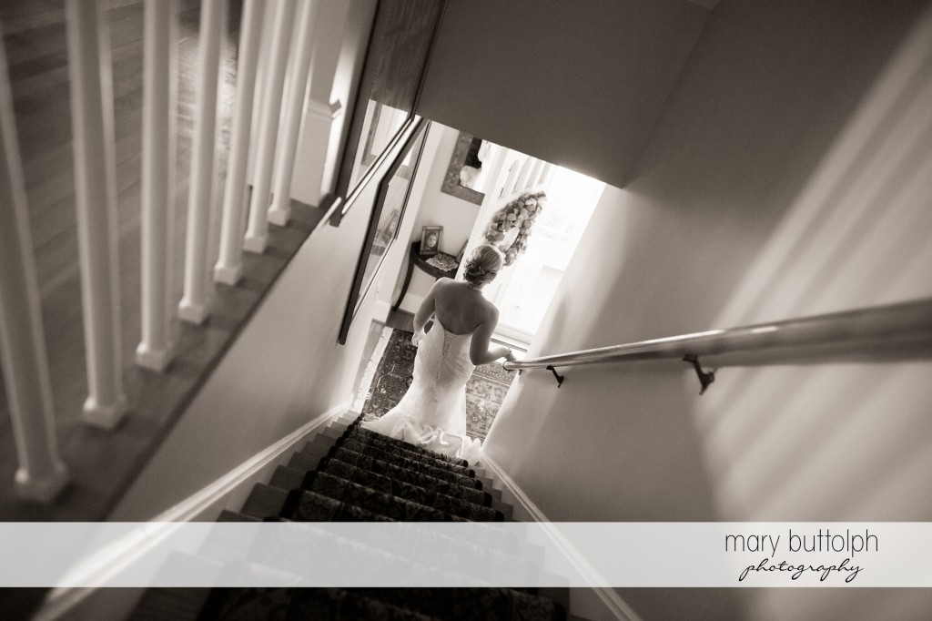 Long shot of bride going downstairs at Emerson Park Pavilion Wedding