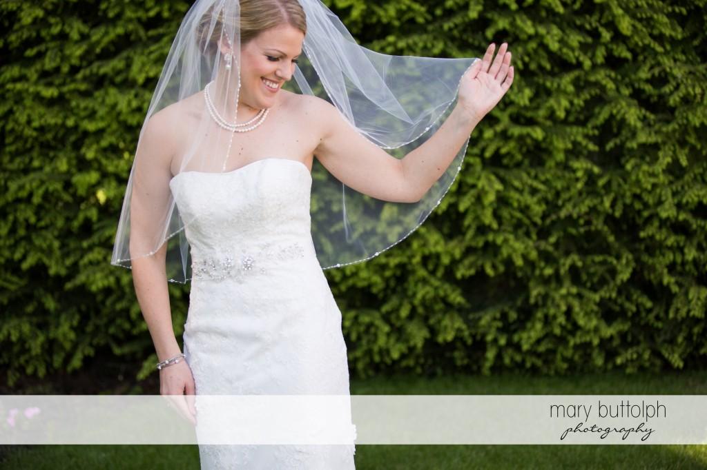 Veiled bride in the garden at Emerson Park Pavilion Wedding