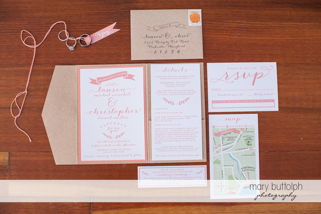 The couple's wedding invitations and wedding rings at Emerson Park Pavilion Wedding