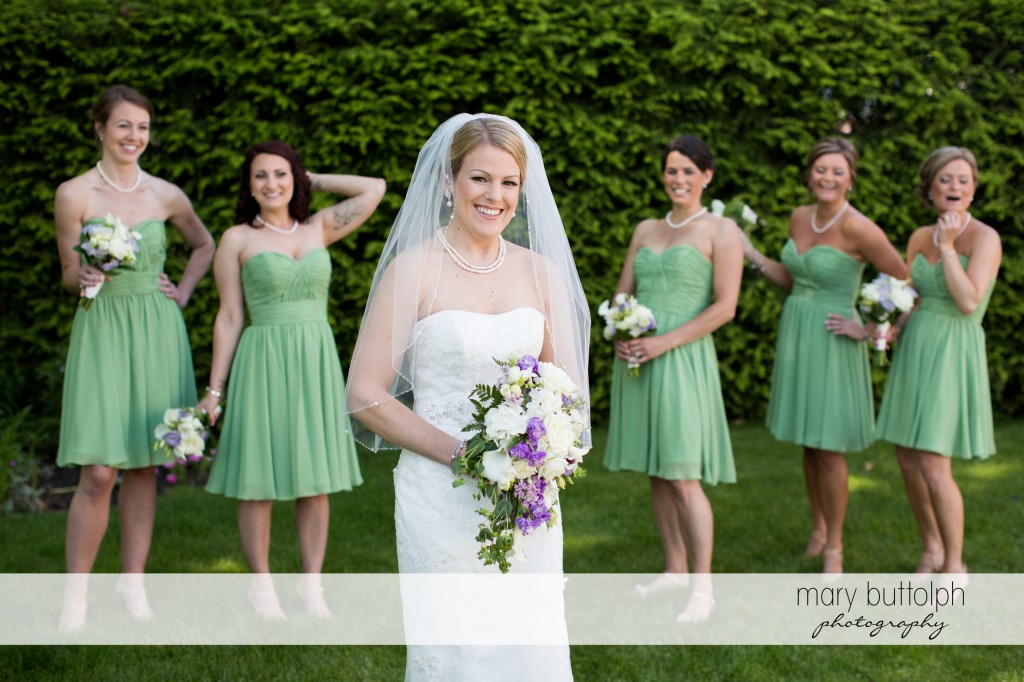 Bride and her bridesmaids in the garden at Emerson Park Pavilion Wedding