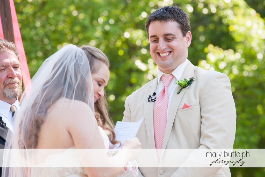 Couple exchange wedding vows in front of the wedding officiant at Emerson Park Pavilion Wedding