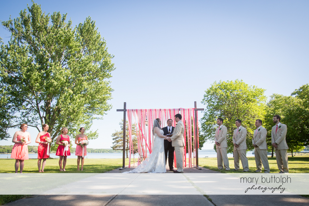 Couple face the wedding officiant at the garden wedding at Emerson Park Pavilion Wedding