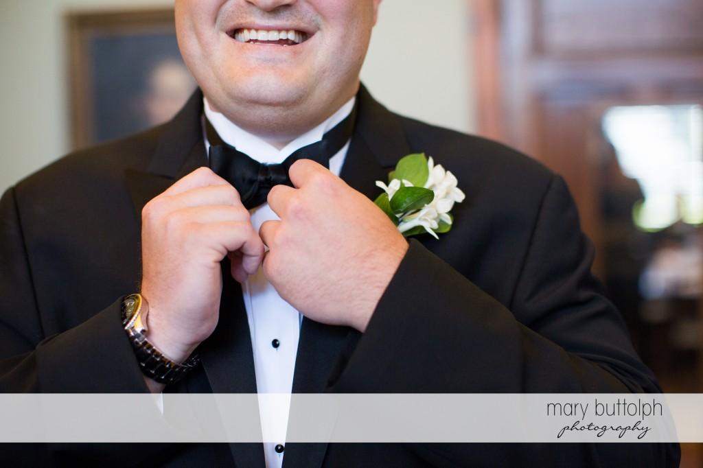 Groom fixes his tie at Emerson Park Pavilion Wedding