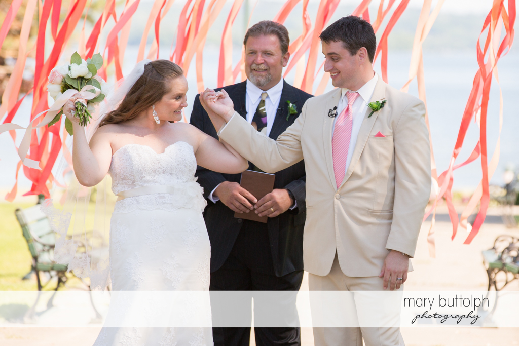 Couple raise their hands after the wedding at Emerson Park Pavilion Wedding