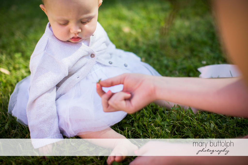Young girl plays on the grass at Emerson Park Pavilion Wedding