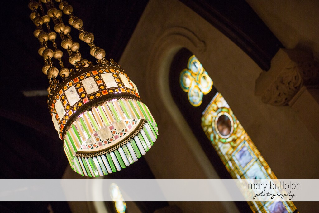 The church's beautiful stained window and chandelier at Emerson Park Pavilion Wedding