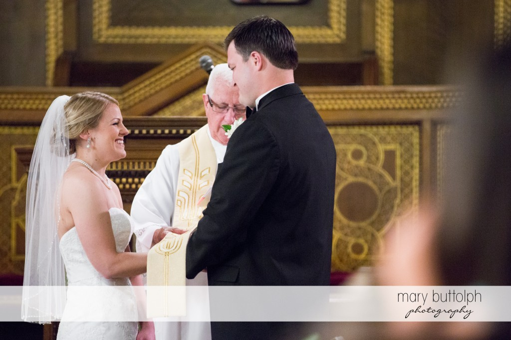 Couple hold hands in front of the priest at Emerson Park Pavilion Wedding