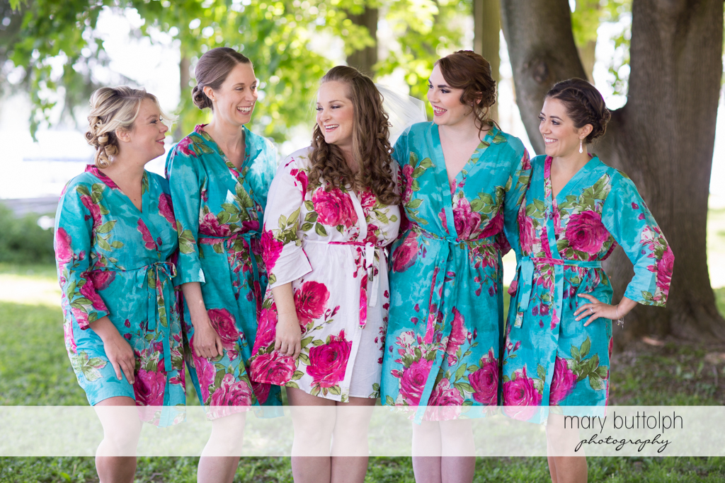 The bride and her bridesmaids in the garden at Emerson Park Pavilion Wedding