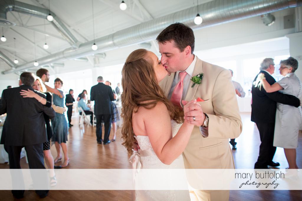 Couple kiss while dancing at Emerson Park Pavilion Wedding