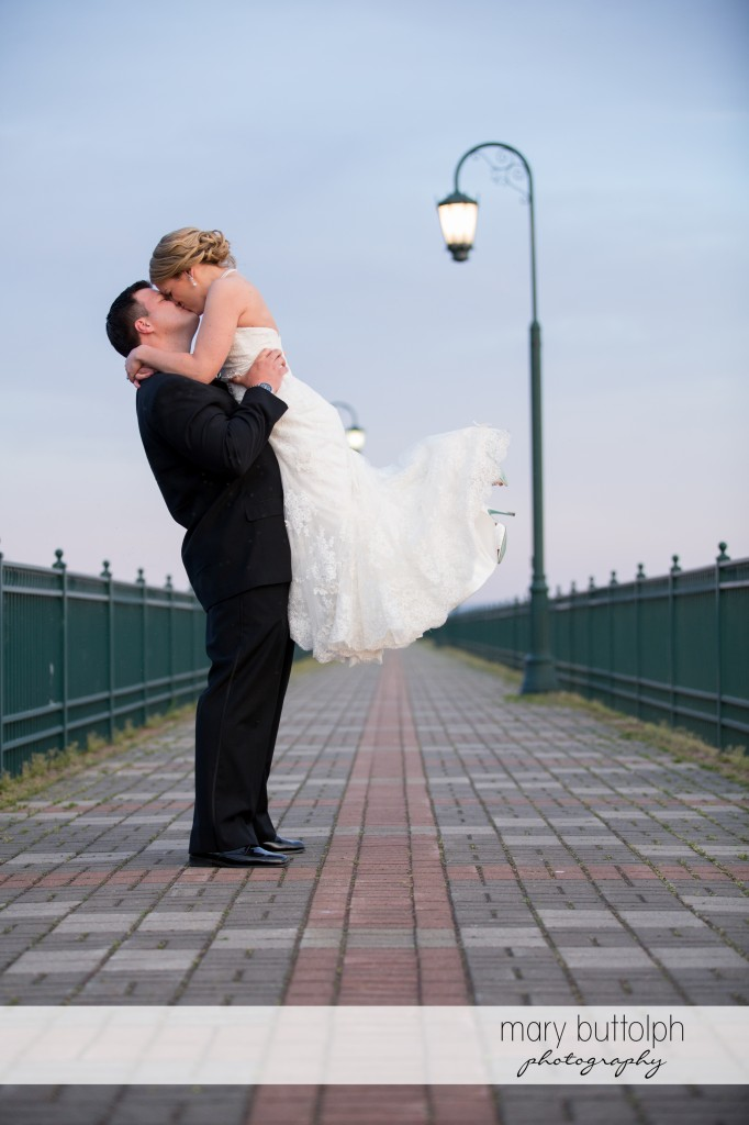 Couple kiss on the walkway at Emerson Park Pavilion Wedding