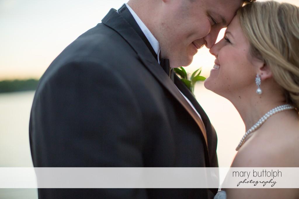 Couple rub noses at Emerson Park Pavilion Wedding