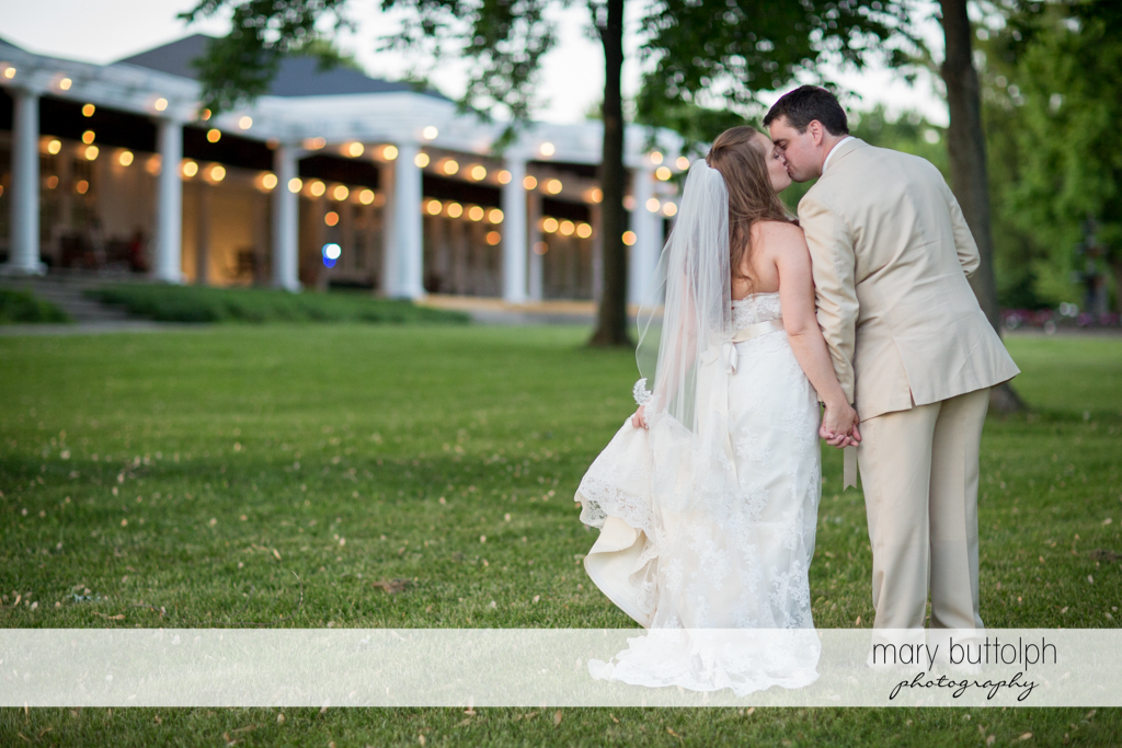 Kissing couple in front of the wedding venue at Emerson Park Pavilion Wedding