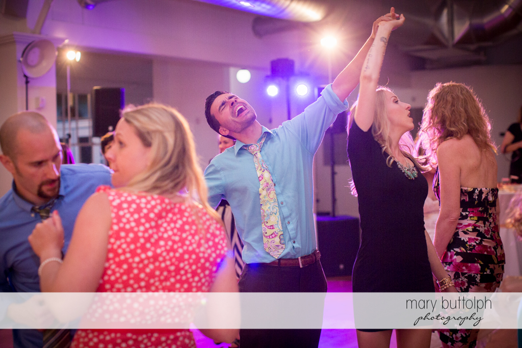 Guests party on the dance floor at Emerson Park Pavilion Wedding