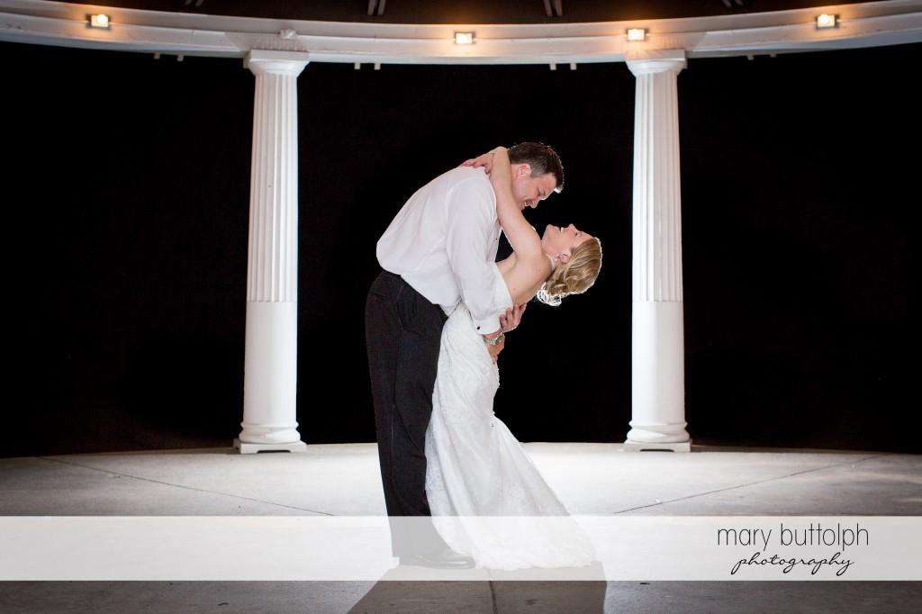 Couple embrace in the gazebo at Emerson Park Pavilion Wedding