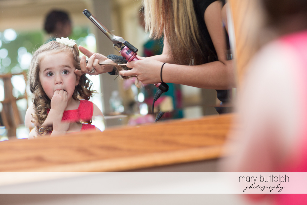 Young girl gets pretty curls with the help of a curling iron at Emerson Park Pavilion Wedding
