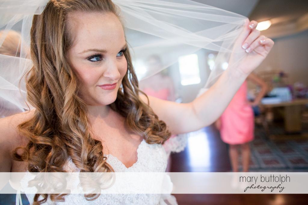 Bride holds her wedding veil up at Emerson Park Pavilion Wedding